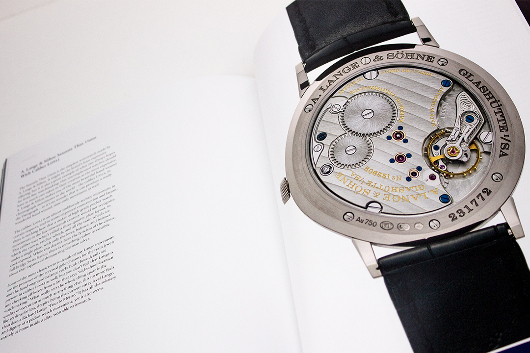 Image of spread page 150-151 from article Back To Basics discussing time-only hand-wound movement watches. Watch shown is an A. Lange & Söhne Saxonia Thin 37 mm, or 1.45″, with Caliber L093.1.
