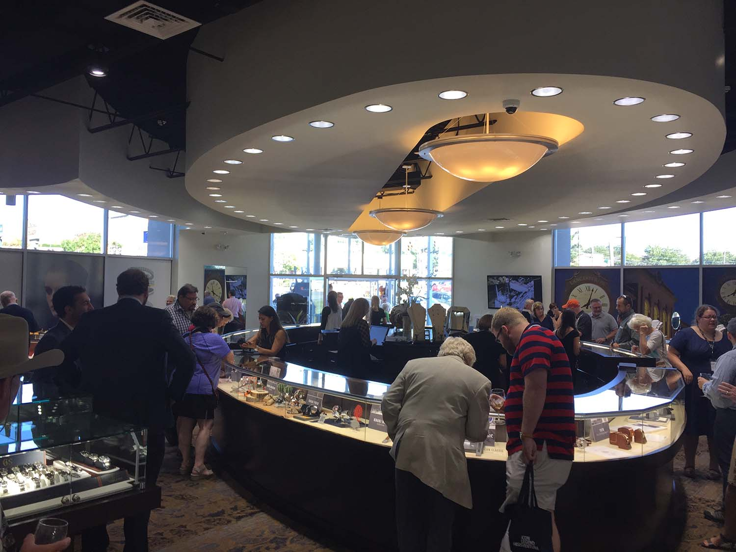 Visitors viewing new and old Hamilton wristwatches and artifacts in the main showroom at Brent L. Miller Jewelers & Goldsmiths in Lancaster, PA.