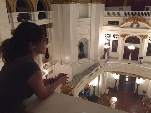 Red-haired young women looking over a marble railing into the atrium inside the Harrisburg, PA Capitol Building