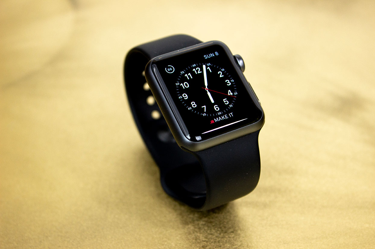 black-cased Apple Watch with a black strap