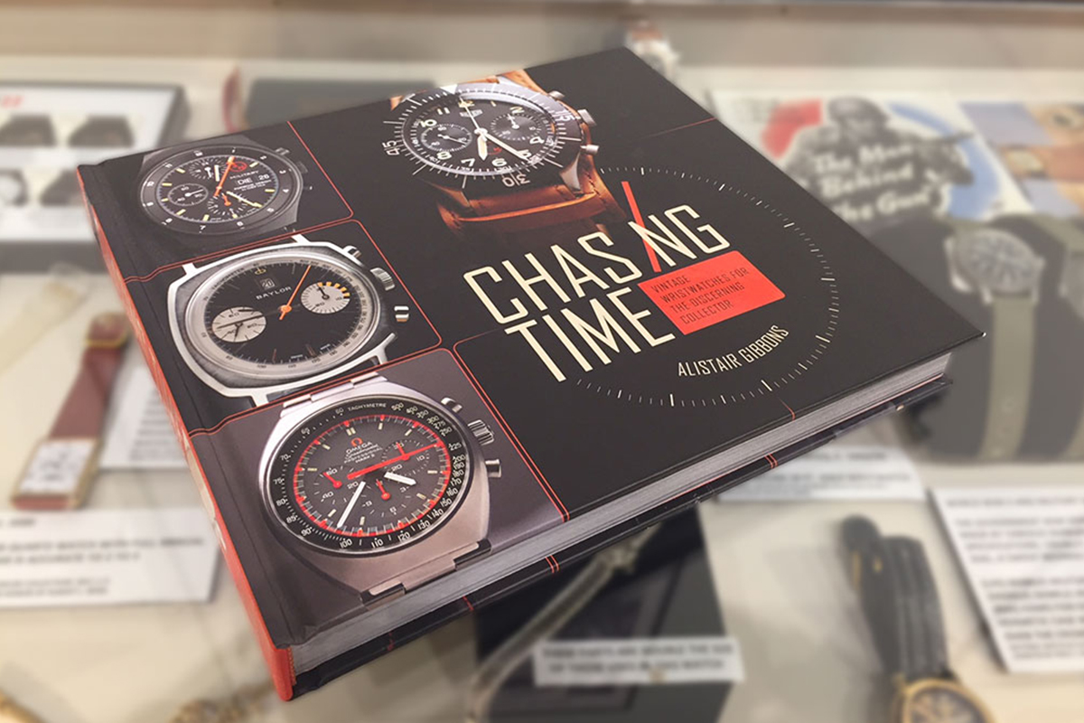 Chasing Time book resting on top of display of wristwatches