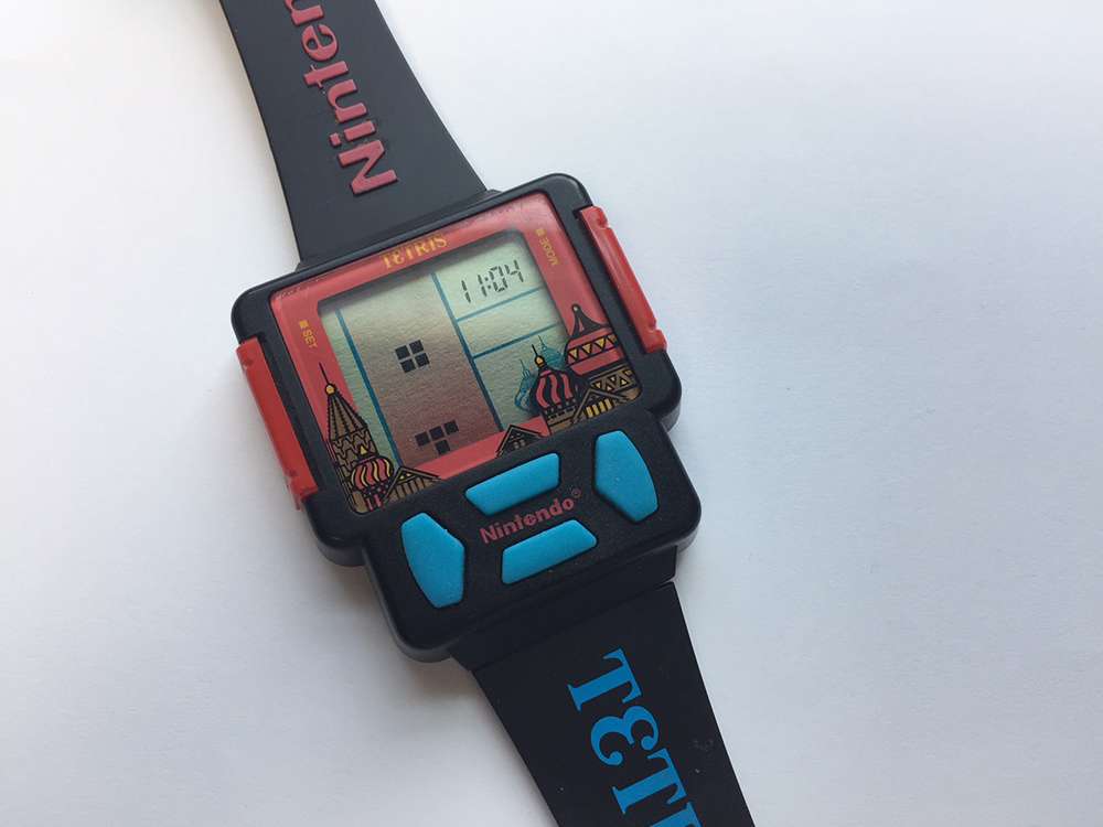 Delsonic Tetris game watch laying on white background